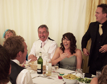 Close up magician causing fits of laughter amongst the wedding guests with his close up magic