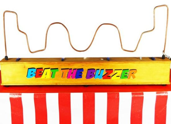 Giant Buzzer Classic Arcade Game With Colourful Lettering And Candy Stripe Decoration