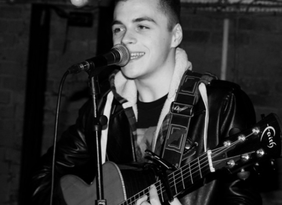 Ben Performing Live Guitar & Vocals Wearing Black Leather Jacket