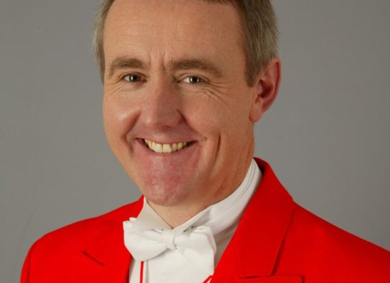 Professional Toastmaster & MC Robert in Full Red Coat Regalia With Medals of Office