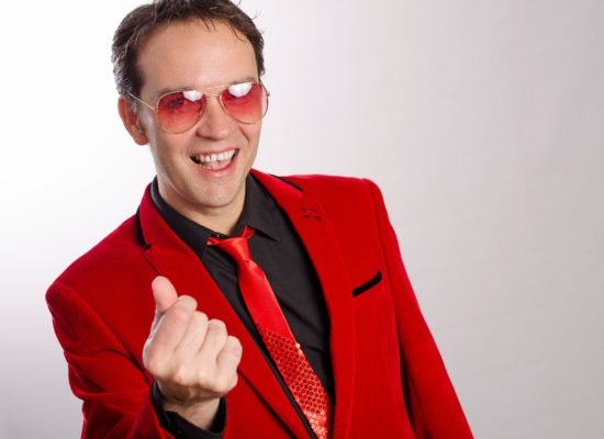 Cliff Richard Tribute Act Wearing a Red Suit And Red Sunglasses