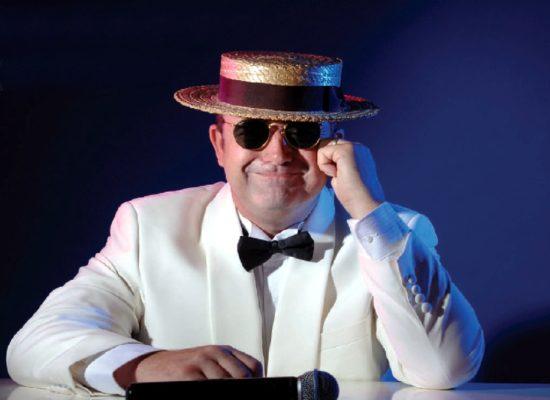 Elton John Tribute Sitting At Piano Wearing A White Tuxedo
