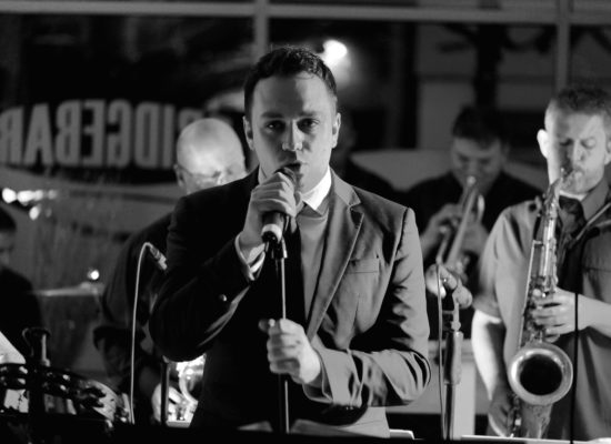 Shanes Swing Band Black & White Image With Singer Shane In The Foreground