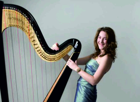 Heather Professional Harpist Posing By Her Black Harp