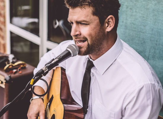 Jay Guitar & Vocals Performing Outdoors For A Corporate Drinks Reception