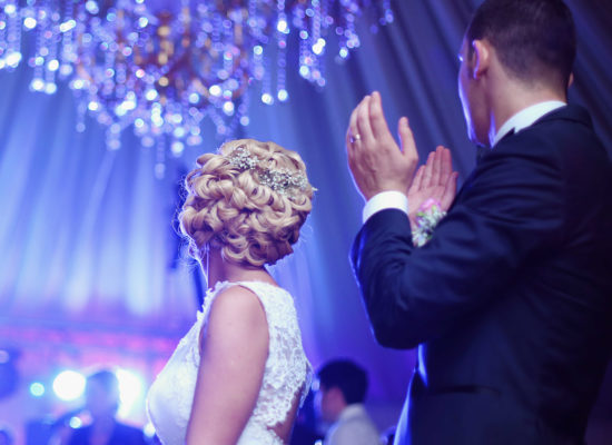 Wedding Couple Beneath a Crystal Chandelier